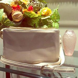 Cream colored crossbody or shoulder purse